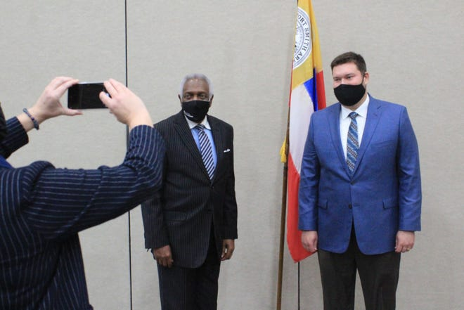 New Fort Smith Vice Mayor Jared Rego, right, stands with Mayor George McGill, center, as City Communication Manager Shari Cooper takes their picture following a Board of Directors meeting on Tuesday, Jan. 5, 2021, at the Fort Smith Convention Center.