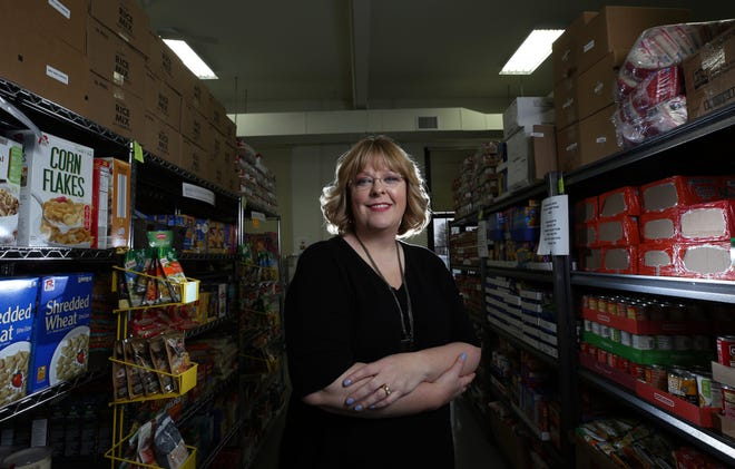 Vanessa Niekamp, executive director of the Pickerington Food Bank, is shown at the pantry Jan. 6. Niekamp said a $10,000 donation from a local couple will offset the 20% reduction in grant funding from the United Way of Fairfield County.