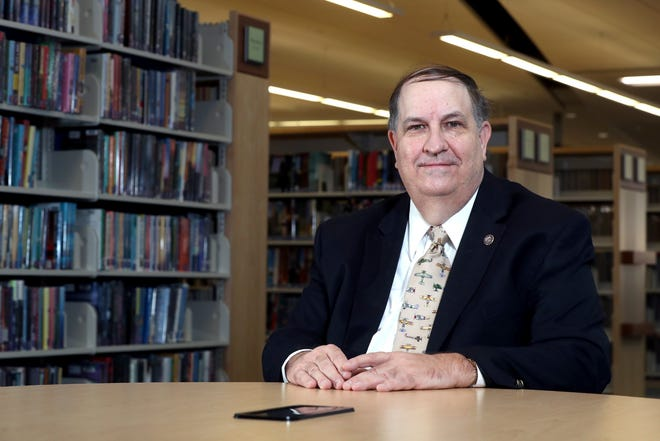 Mark Shaw, pictured Jan. 5 at the Grove City Library, is retiring as the Southwest Public Libraries director effective Jan. 29.