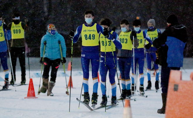 Acton-Boxborough's Tommy Vialle, number 849, jumped up and down as he and his teammates waited for the start of their Mass Bay West cross country ski race at the Weston Ski Track, Jan. 5, 2021.