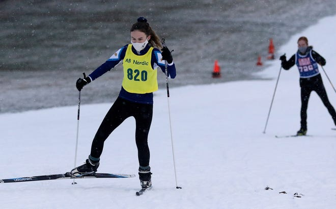 Acton-Boxborough's Elizabeth Howard worked her way up the incline during the Mass Bay West cross country ski race at the Weston Ski Track, Jan. 5, 2021.