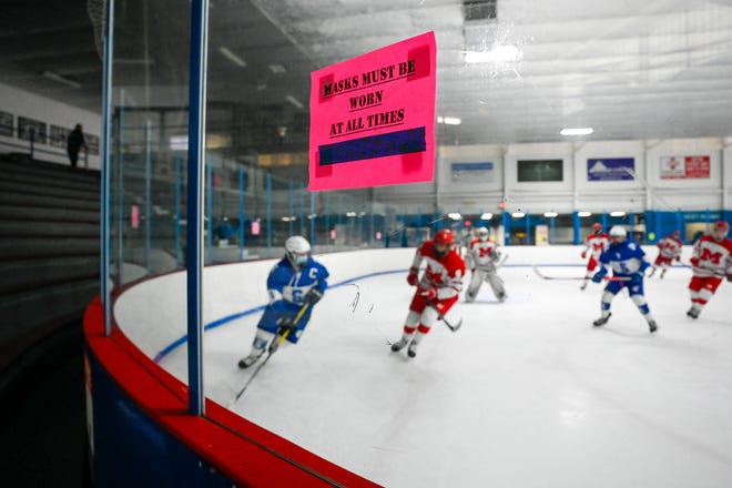 Signs around statewide ice rinks like the one shown above in the Stoneham Arena remind guests about social distancing measures amid the coronavirus pandemic this year. While also following these guidelines to stay safe, the Melrose Red Raiders made history of sorts, when they clinched the Middlesex League Freedom Division title for the first time in years.