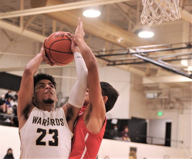 Abilene High's D.J. Modest (23) drives against an Odessa High defender in the first half. The Eagles beat Odessa 81-67 in the District 2-6A game Tuesday at Eagle Gym.