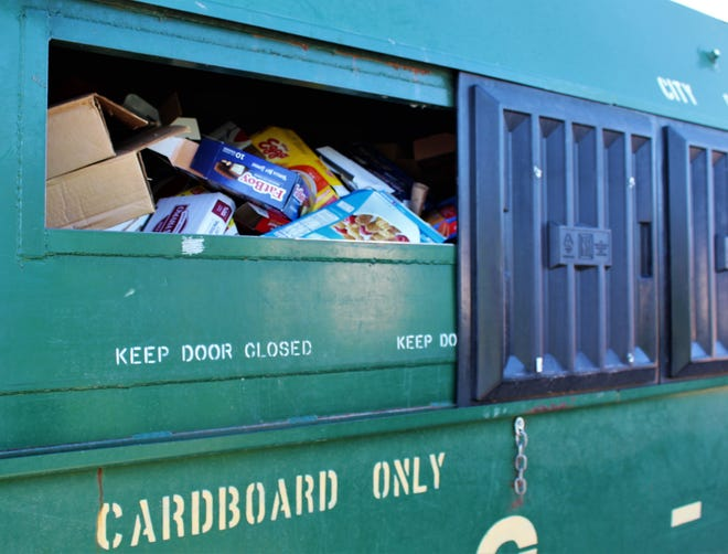 A recycling container for cardboard was full Wednesday at the H-E-B dropoff site.