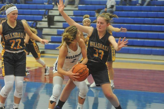 Crestline's Hannah Delong tries to get around Hillsdale's Kayla Vistucis under the basket.