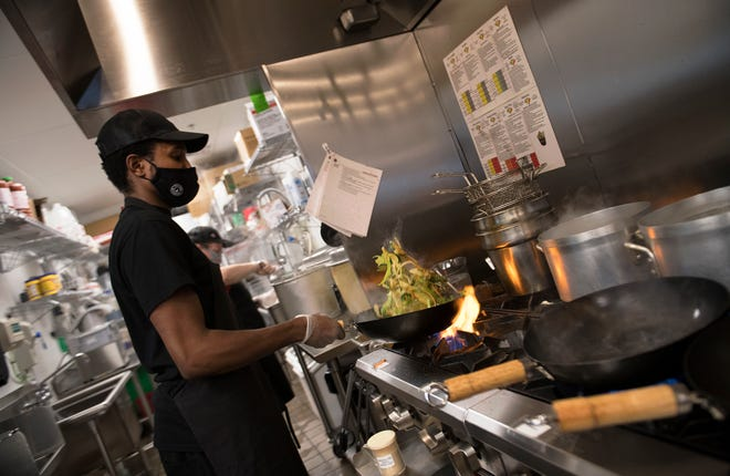 Chef Zeek Williams of Lindenwold cooks in the kitchen of Teriyaki Madness in Marlton.