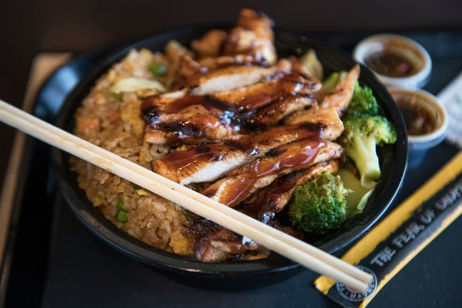 Teriyaki chicken breast with fried rice is displayed in Teriyaki Madness in Marlton.