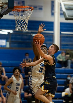 Chillicothe's Donavin Baker attempts to block Lancaster's Cameron Roundabush as he tries to take it to the rim Tuesday night at Chillicothe Ohio.  Lancaster defeated Chillicothe 65-51.