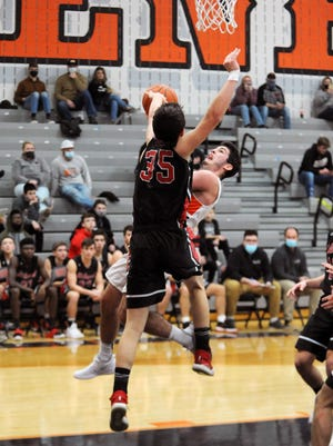 Ridgewood's Gabe Tingle goes up for a shot over Hiland's Ryan Miller during the Generals' 51-49 loss on Tuesday night in West Lafayette.