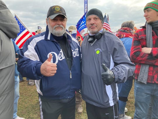 """Mike Cooley, left, and Joe Cowdrey, right, drove to D.C. from Michigan after hearing about the protest online. """"We don't mind losing, but we want it to be fair,"""" Cowdrey said."""