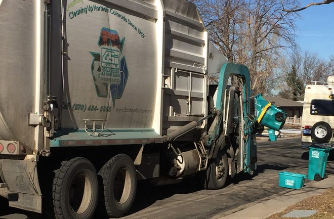 Gallegos Sanitation picks up trash and recyclables in west Fort Collins Jan. 6. Gallegos, family owned for 61 years, sold to Arizona-bases waste collector Republic Services.