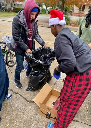 Instead of buying each other a Christmas gift, two siblings in Lafayette choose to put that money toward helping others each year. Payton Gary, 14, and Normandie Cormier, 20, spent much of last monthpreparing and packaging essential holiday care packages to deliver to the homeless in Lafayette.