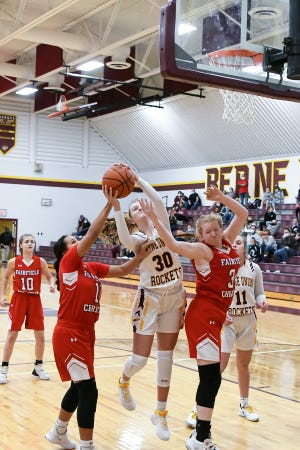 Berne Union senior Bella Kline grabs a rebound in between Fairfield Christian's Jenna Grabans (left) and Lannah Prysi during a game earlier this season. The Rockets are ranked No. 1 in the state in the Division IV Associated Press poll.