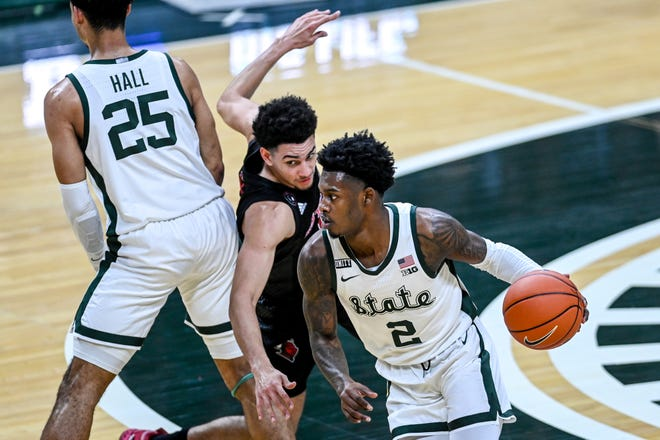 Michigan State's Rocket Watts, right moves with the ball against Rutgers during the second half on Tuesday, Jan. 5, 2021, at the Breslin Center in East Lansing.