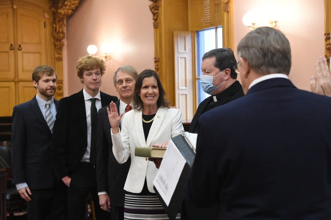 Tracy Richardson takes the oath of office for her second term as a member of the Ohio House of Representatives.