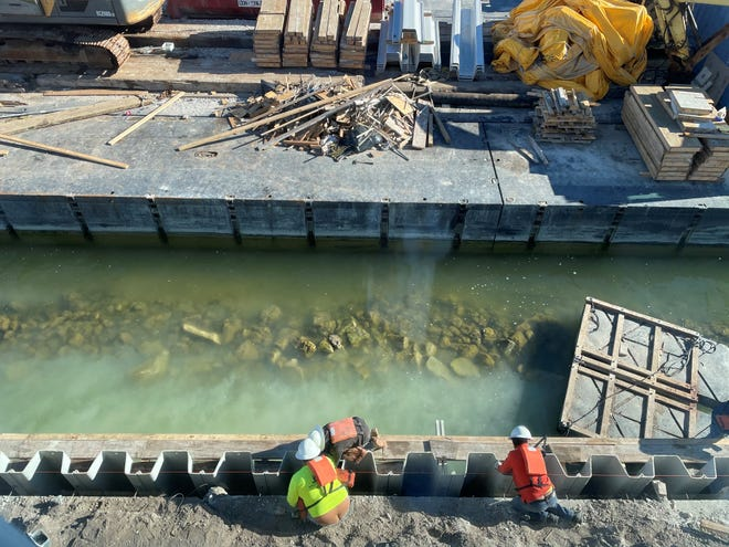 Workers build a new seawall at Marco Island Yacht Club on Jan. 6, 2021.