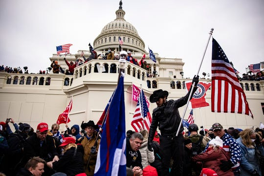 Pro-Trump supporters storm the U.S. Capitol following a rally with President Donald Trump on January 6, 2021 in Washington, DC. Trump supporters gathered in the nation's capital to protest the ratification of President-elect Joe Biden's Electoral College victory over President Trump in the 2020 election.