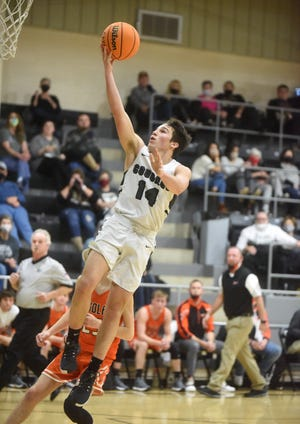 Izard County's Coby Everett goes up for two against Viola during a recent contest. Izard County will host the 1A Region 2 basketball tournament this season, it was announced Thursday.