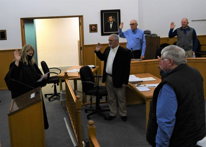 Circuit Court Judge Johnnie Copeland (far left) swears in Baxter County justices of the peace Dennis Frank, Robert Lowery, Roger Steele and Dirk Waldrop on Tuesday night to open the Quorum Court's January meeting.