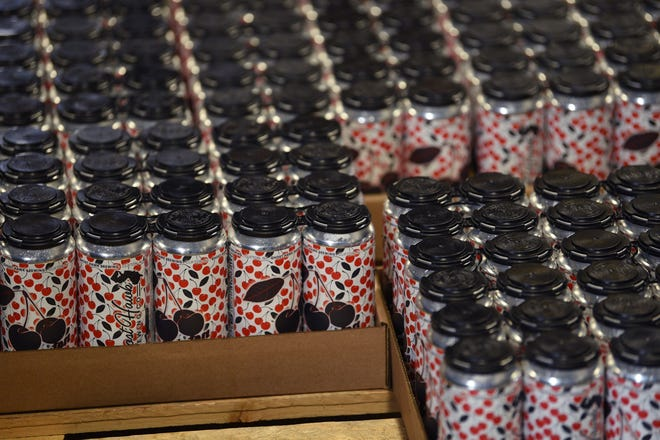Cans of beer in cardboard trays are seen at the end of the process for canning beer. The Mass. House and Senate on Wednesday, Jan. 6, passed a bill that would make it easier for craft brewers to sever their contracts with their distributor. [Gannett photo]