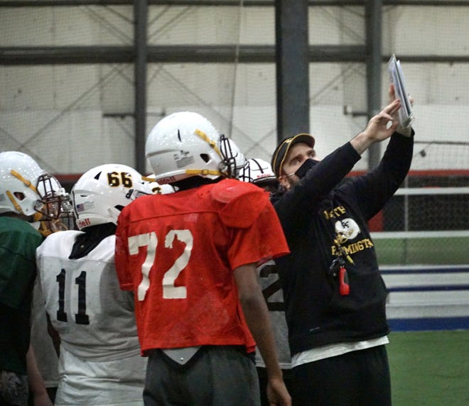 North Farmington football works on a game plan while practicing at total Sports Complex in Wixom before Saturday's game against Traverse City Central.