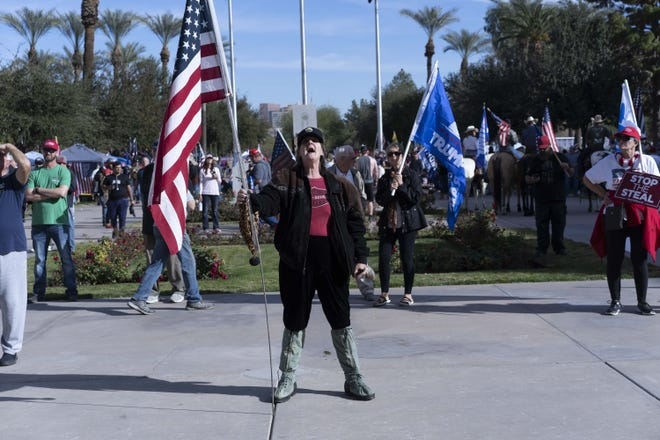 Hundreds came to support President Trump during a rally and protest at the Arizona state Capitol while Congress met to certify the Electoral College vote on Jan. 6, 2021. Violence erupted in Washington, D.C., and disrupted the certification.