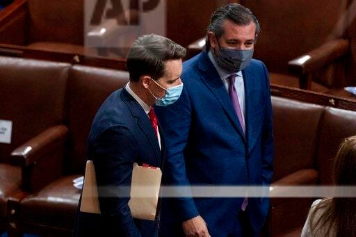 Sen. Josh Hawley, R-Mo., left, and Sen. Ted Cruz, R-Texas, right, speak after Republicans objected to certifying the Electoral College votes from Arizona, during a joint session of the House and Senate to confirm the electoral votes cast in November's election, at the Capitol Wednesday.