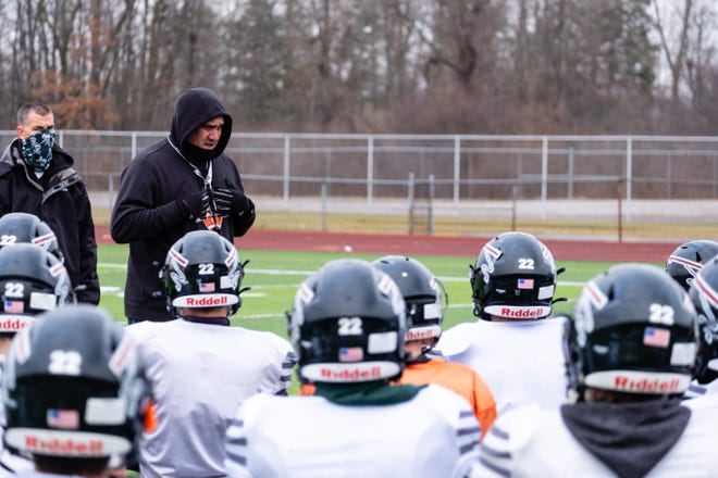 Marine City coach Daryn Letson talks to the team between drills during practice Wednesday, Jan. 6, 2021, at East China Stadium.