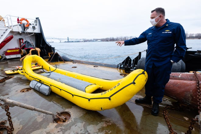 U.S. Coast Guard BOSN William Hosford talks about an inflatable craft used for ice rescues Wednesday, Jan. 6, 2021, on the buoy deck of the USCGC Hollyhock in Port Huron. The raft has three air chambers and can be inflated within a matter of seconds.