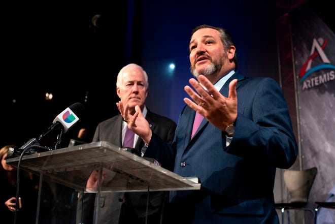 U.S. Sens. Ted Cruz, R-Texas, right, and John Cornyn, R-Texas, take part in the astronaut graduation ceremony at Johnson Space Center on Jan. 10, 2020, in Houston, Texas. (Mark Felix/AFP/Getty Images/TNS)