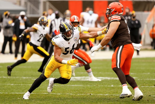 Pittsburgh Steelers linebacker Alex Highsmith (56) attempts to run past Cleveland Browns offensive tackle Jedrick Wills Jr. (71) during an NFL football game on Sunday, Jan. 3, 2021, in Cleveland. (AP Photo/Kirk Irwin)
