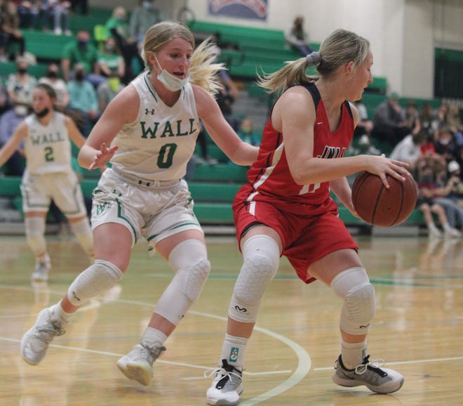 Wall High School's Hannah Burk (0) guards tightly against Jim Ned's Claire Cooley (11) during a District 6-3A girls basketball game Tuesday, Jan. 5, 2021 at the Wall gym.