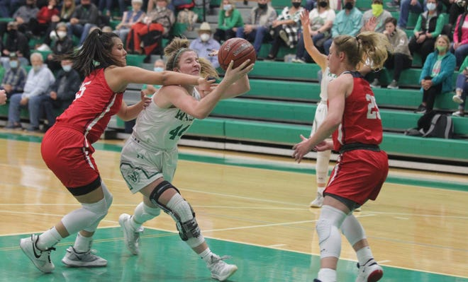Wall High School's Kaitlyn Stephens (44) makes a move inside against the defense of Jim Ned's Alexis Espinosa (15) Claire Graham (25) during a District 6-3A girls basketball game Tuesday, Jan. 5, 2021, at the Wall gym.