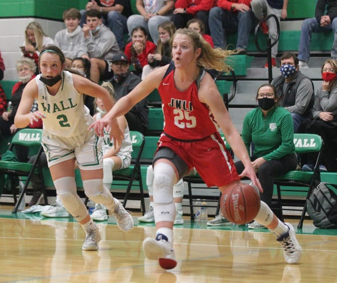Jim Ned High School's Eliesabeth Smith drives the baseline as Wall's Shaylee Shiller calls for defensive help during a District 6-3A girls basketball game Tuesday, Jan. 5, 2021 at the Wall gym.