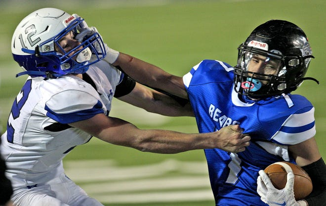 Jadeyn Bryant, left, makes a tackle for Richland Springs during the Class 1A Division II championship game against Balmorhea in San Angelo on Tuesday, Jan. 5, 2021.