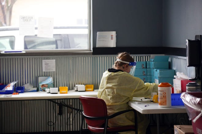 An Avera Health worker processes rapid COVID-19 tests on Wednesday, January 6, at a testing site set up in a former car dealership in Sioux Falls.