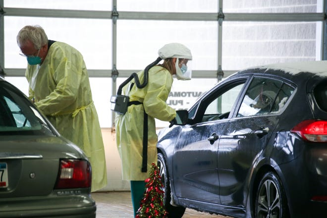 Avera Health workers provide COVID-19 tests to citizens on Wednesday, January 6, at a testing site set up in a former car dealership in Sioux Falls.