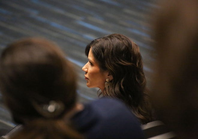Governor Kristi Noem listens to a press conference regarding a new scholarship program on Wednesday, January 6, at Southeast Technical College in Sioux Falls.