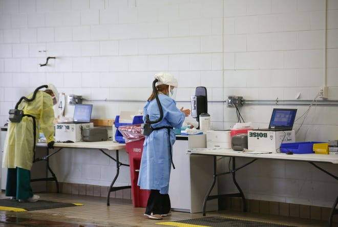 Avera Health workers provide COVID-19 tests on Wednesday, January 6, at a testing site set up in a former car dealership in Sioux Falls.