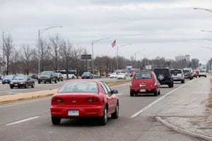 Vehicles drive north on Glenstone Avenue near the Battlefield Mall on Wednesday, Jan. 6, 2021. Glenstone will be getting $12.4 million in improvements starting in 2022.