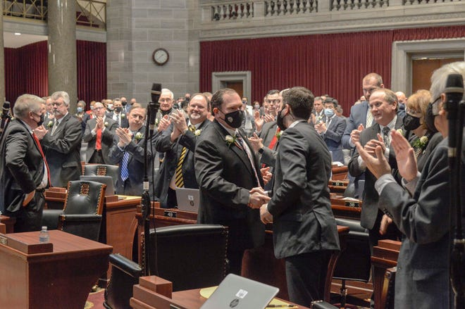 Newly elected House Speaker Rob Vescovo, R-Arnold, shakes hands with colleagues on the House floor Wednesday, Jan. 6, 2021.