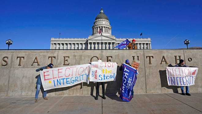 People attend a rally in support of President Donald Trump Wednesday, Jan. 6, 2021, in Salt Lake City. (AP Photo/Rick Bowmer)