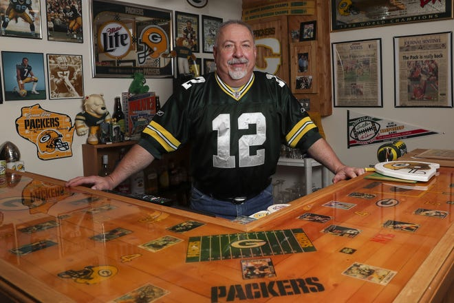 Pat Suplicki stands behind his wet bar on Wednesday at his home in Stevens Point. Suplicki was recently named one of 10 finalists for the Packers FAN Hall of Fame.