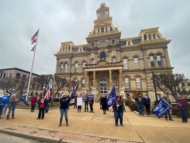 Around 20 Muskingum County residents gathered in front of the courthouse Wednesday to support President Donald Trump while Congress was meeting to count the Electoral College votes.