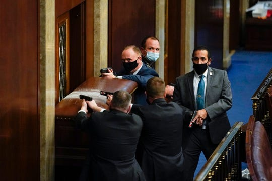 Capitol police guard a barricaded door as protesters try to break into the House chamber at the U.S. Capitol on Jan. 6.