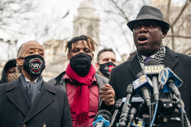 Attorney Ben Crump, right, at a news conference on Dec. 30, 2020, held for the family of Keyon Harrold Jr., along with the Rev. Al Sharpton, left, and Keyon Harrold Sr.