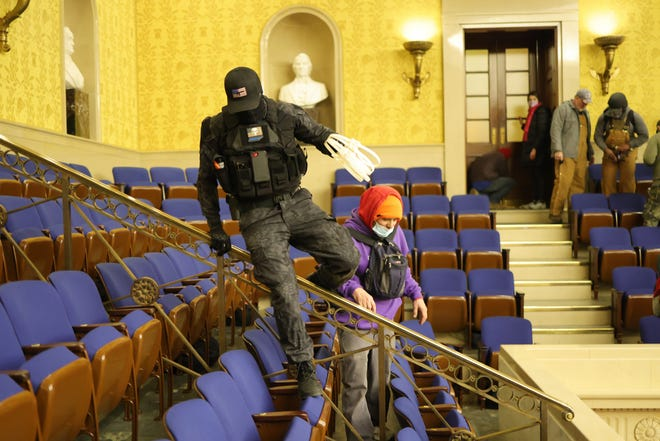Rioters enter the Senate chamber on Jan. 6, 2021, in Washington, D.C.