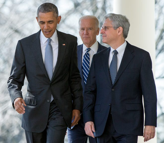 Federal appeals court judge Merrick Garland arrives with President Barack Obama and Vice President Joe Biden as he is introduced as Obama's nominee for the Supreme Court during an announcement in the Rose Garden of the White House, in Washington, March 16, 2016.