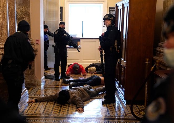 U.S. Capitol Police detain protesters outside of the House Chamber during a joint session of Congress on January 06, 2021 in Washington, DC.