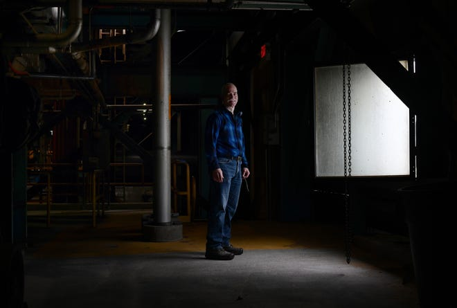 Todd Behrend stands inside the shuttered facility in Usk, Washington.
